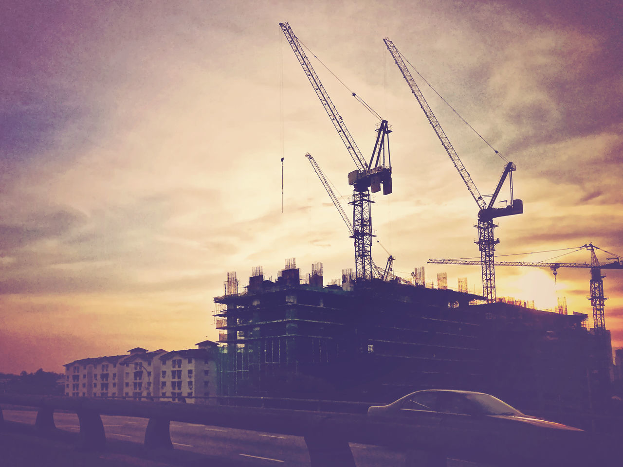 Architecture Building Exterior Built Structure City Cityscape Cloud - Sky Construction Day Development Going Home Industry No People Outdoors Road Silhouette Sky Sunset