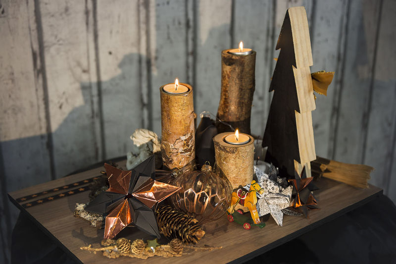 Christmas decoration in colors copper bronze black and white from above Bronze Christmas Christmas Eve Christmas Balls Fir Tree Holy Night Nature Wood X - Mas Black Candle Copper  Darkly Decoration Decoration Flame Four Candles High Angle View Paper Stars Self Made Stars Trunk White Wood - Material Wood Background