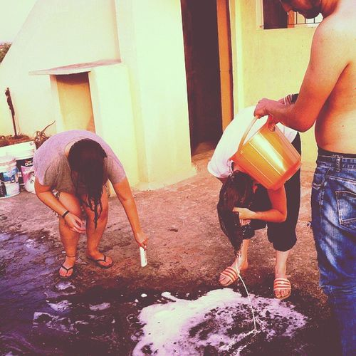 46°C in delhi and we are without water.. so what to do then? answer: go to the rooftop, 'borrow' the water from the neighbour's tank and just wash your hair right there! we call this the: Sharingiscaringborrowwaterfromyourneighbourbucketchallenge or short version Sicbwfynbchallenge