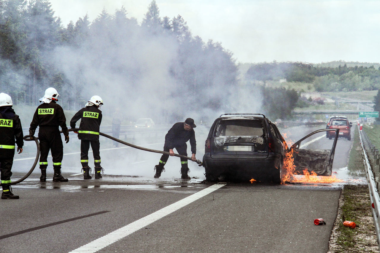 Burning Car Road Accident Car Day Extinguishing Car Fire Firefighters Firefighters In Action Men Outdoors People Road Accident