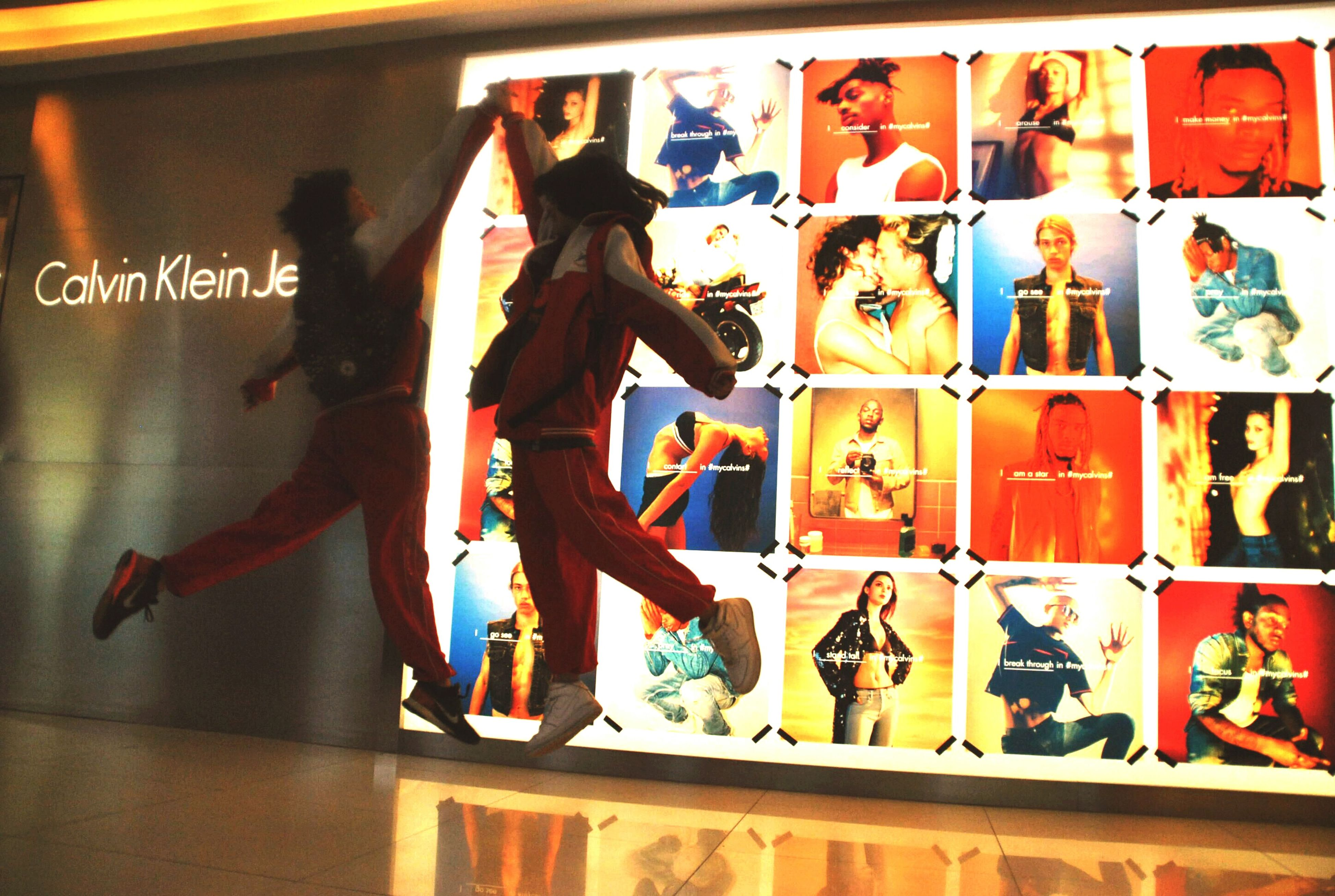 indoors, lifestyles, text, men, communication, leisure activity, human representation, western script, full length, person, animal representation, art, non-western script, standing, creativity, architecture, art and craft, built structure