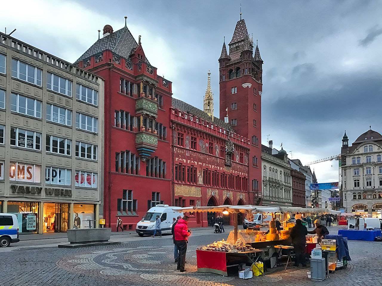 The market square and the town hall of Basel in Switzerland. Architecture Basel Booth Building Exterior Buildings Cars City Clouds Day Illumination Market Square Outdoors People Red Sky Switzerland Town Hall