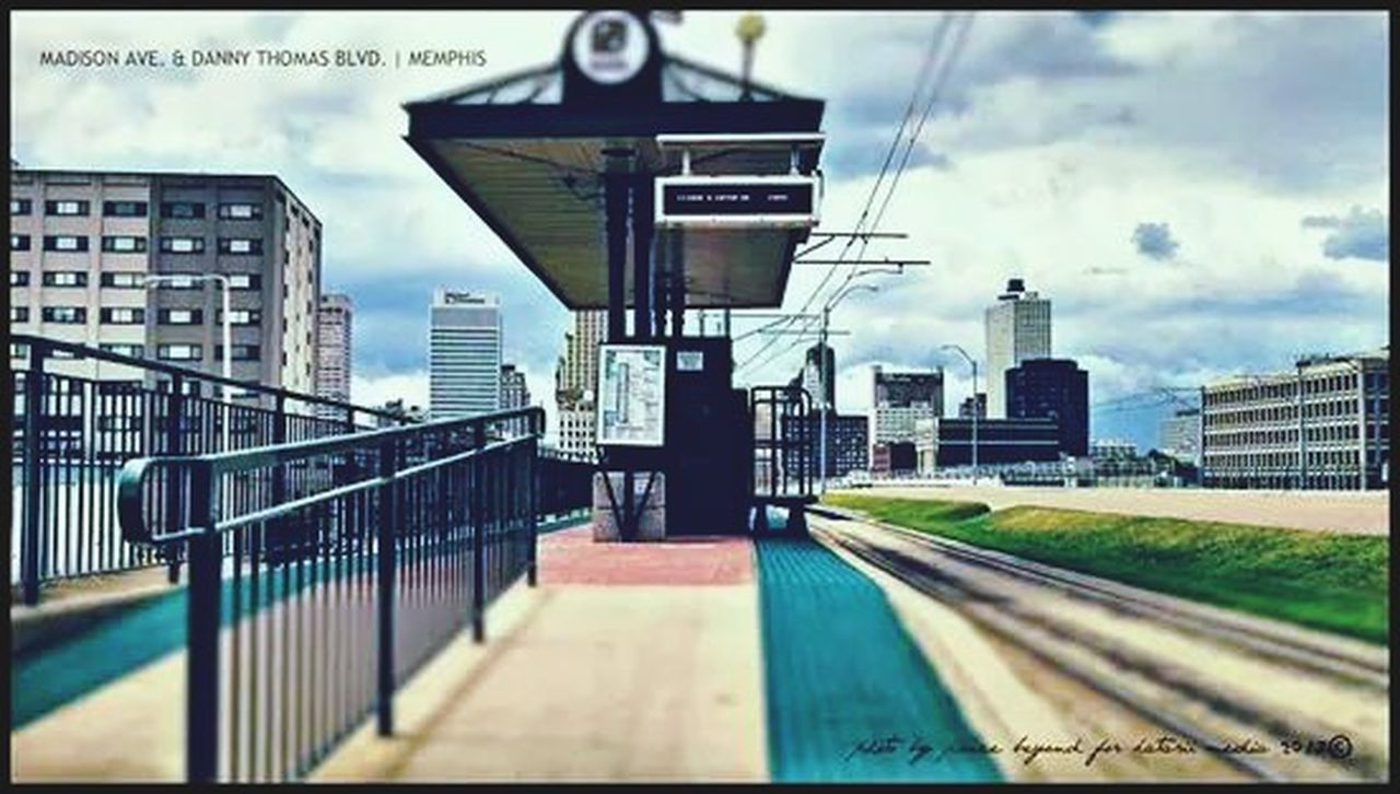 architecture, built structure, building exterior, city, city life, skyscraper, day, outdoors, railroad track, no people, sky, urban skyline, modern, cityscape