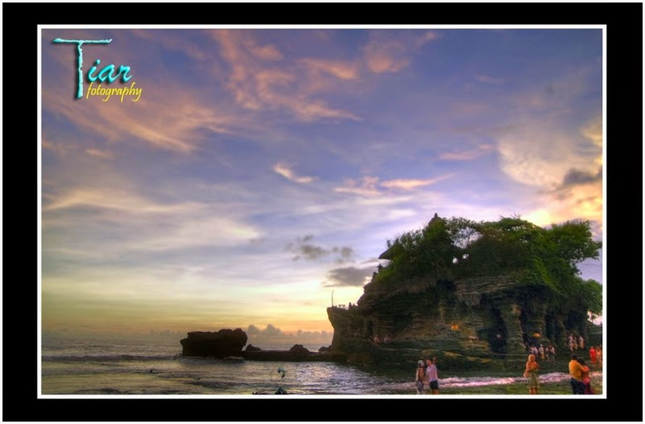 tanah Lot..BALI Enjoying The Sun Tourists Sightseeing Visiting