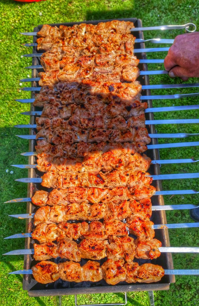High Angle View Of Meat Cooking On Barbecue Grill In Yard