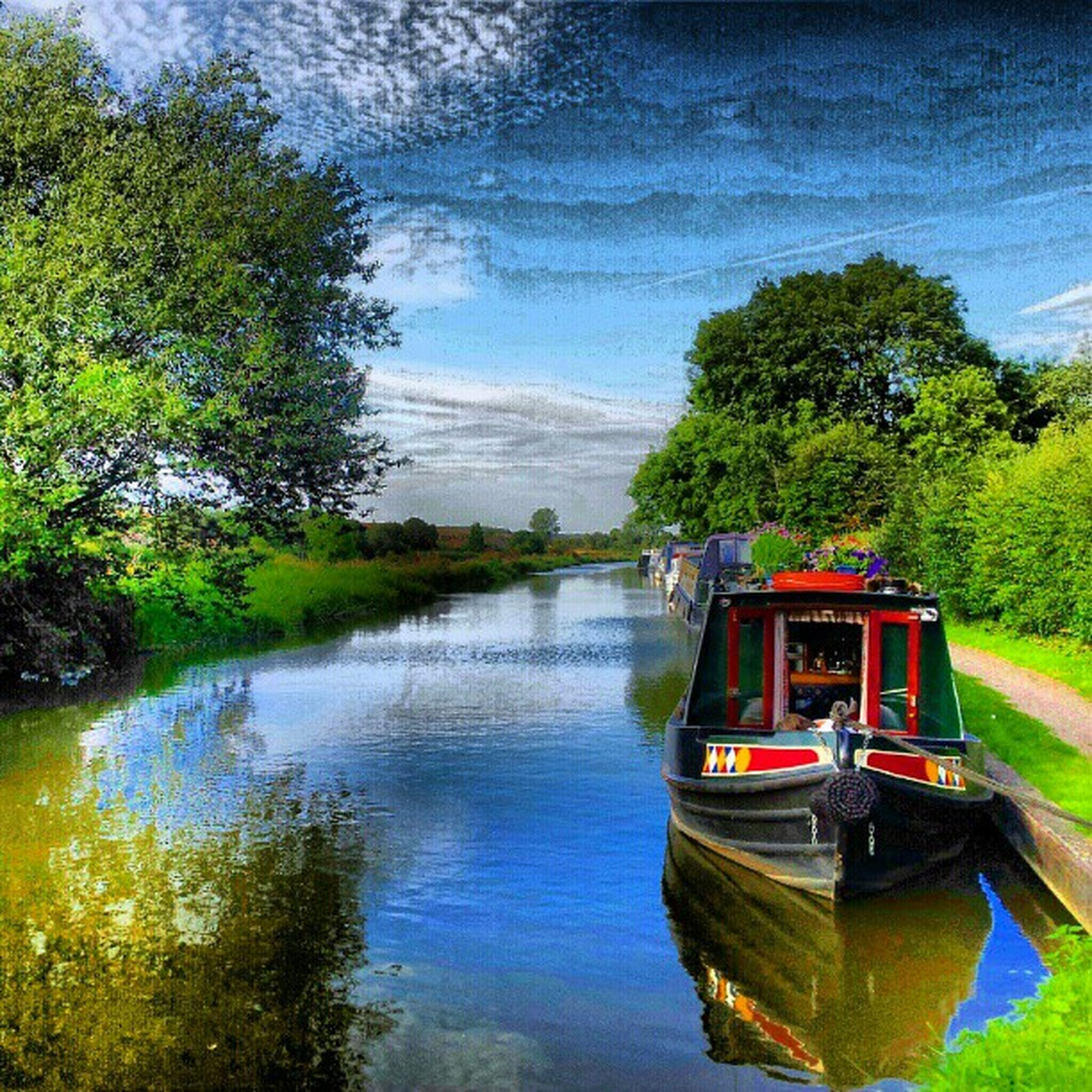 water, tree, reflection, nautical vessel, transportation, mode of transport, boat, lake, tranquility, sky, tranquil scene, moored, nature, scenics, beauty in nature, growth, river, cloud - sky, green color, waterfront