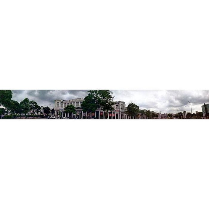 Panoramic view of Connaught Place during the monsoon season. X ConnaughtPlace Delhi India Indiapictures Monsoon Rain Indiagram Travelgram Naturegram Sodelhi DelhiGram Dilli Centraldelhi Greenery Windy Panorama WhenInDelhi Incredibleindia