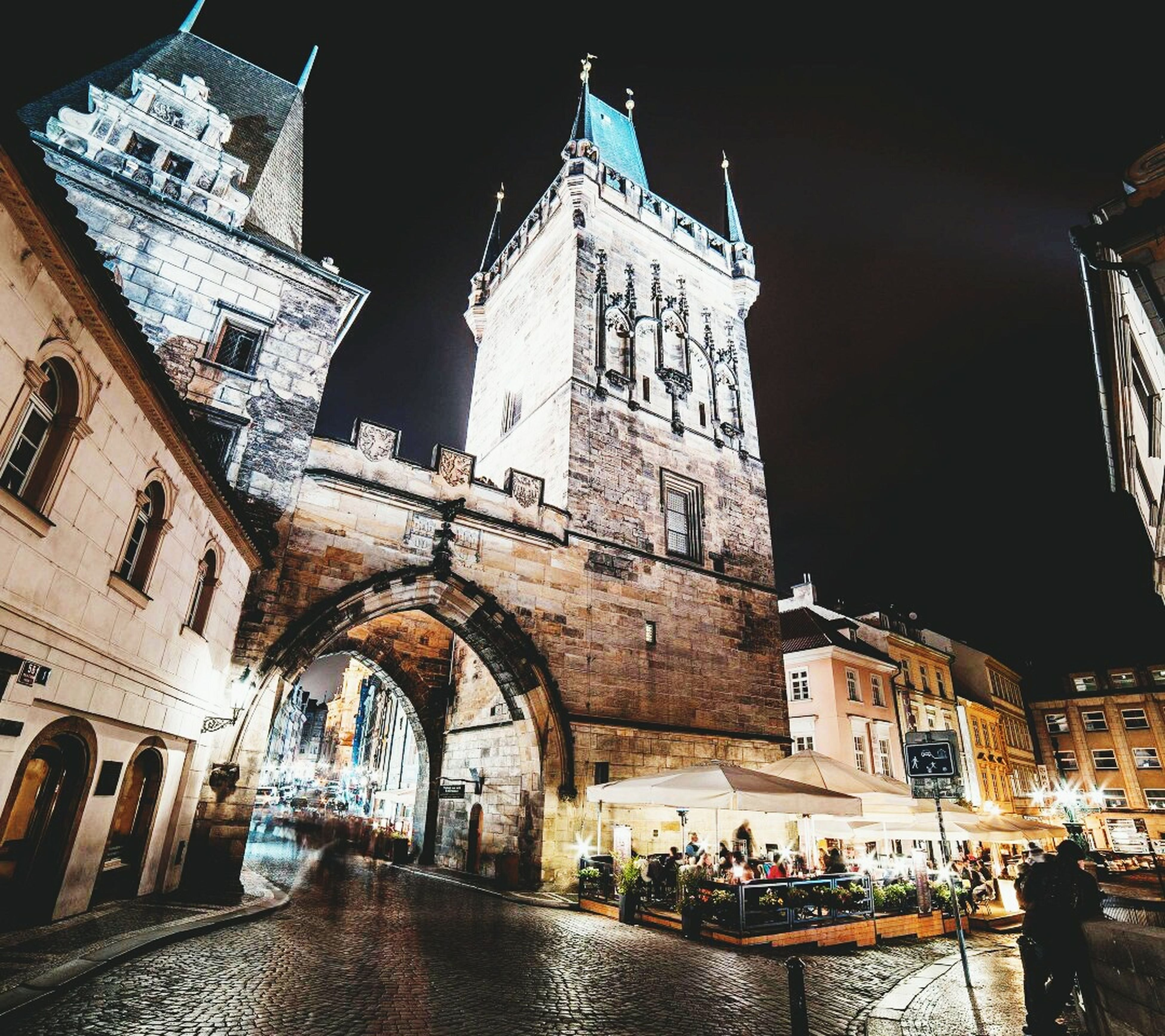 night, illuminated, travel destinations, architecture, building exterior, clock, city, outdoors, time, christmas, large group of people, clock tower, astronomical clock, christmas market, sky, people