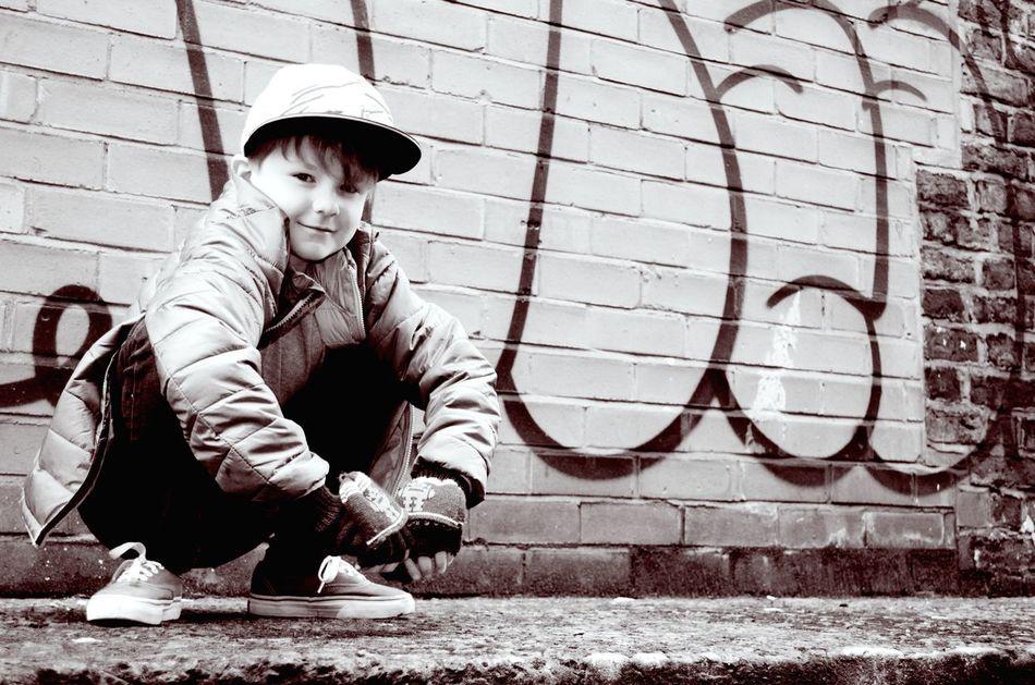 . My Boy Model Boy Gangster Style Graffiti Street Art Boy Crouching On A Wall Urban Boy