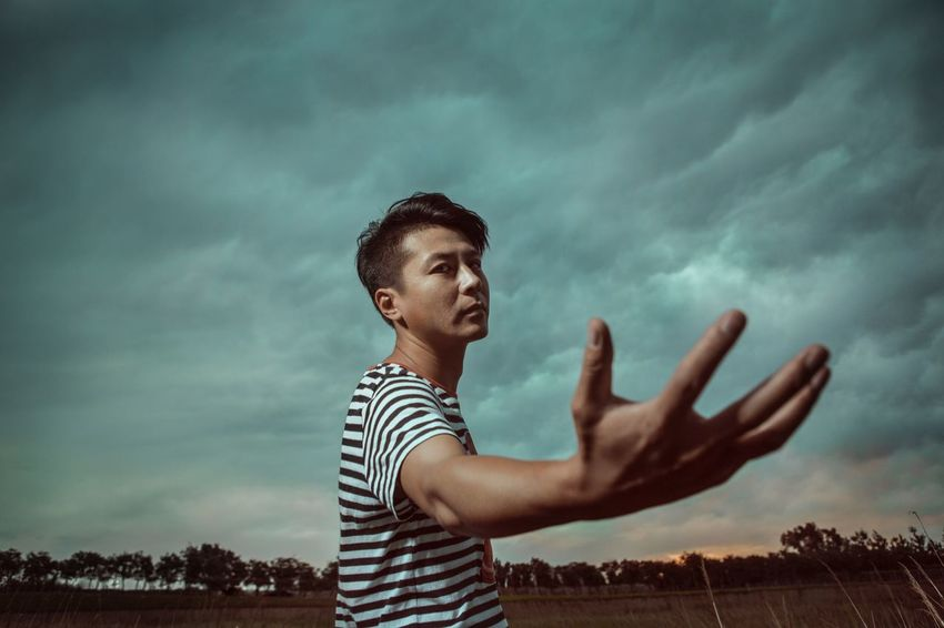 Gesturing Striped Young Adult One Person Cloud - Sky Young Women Real People Sky Day Outdoors Nature Human Hand People