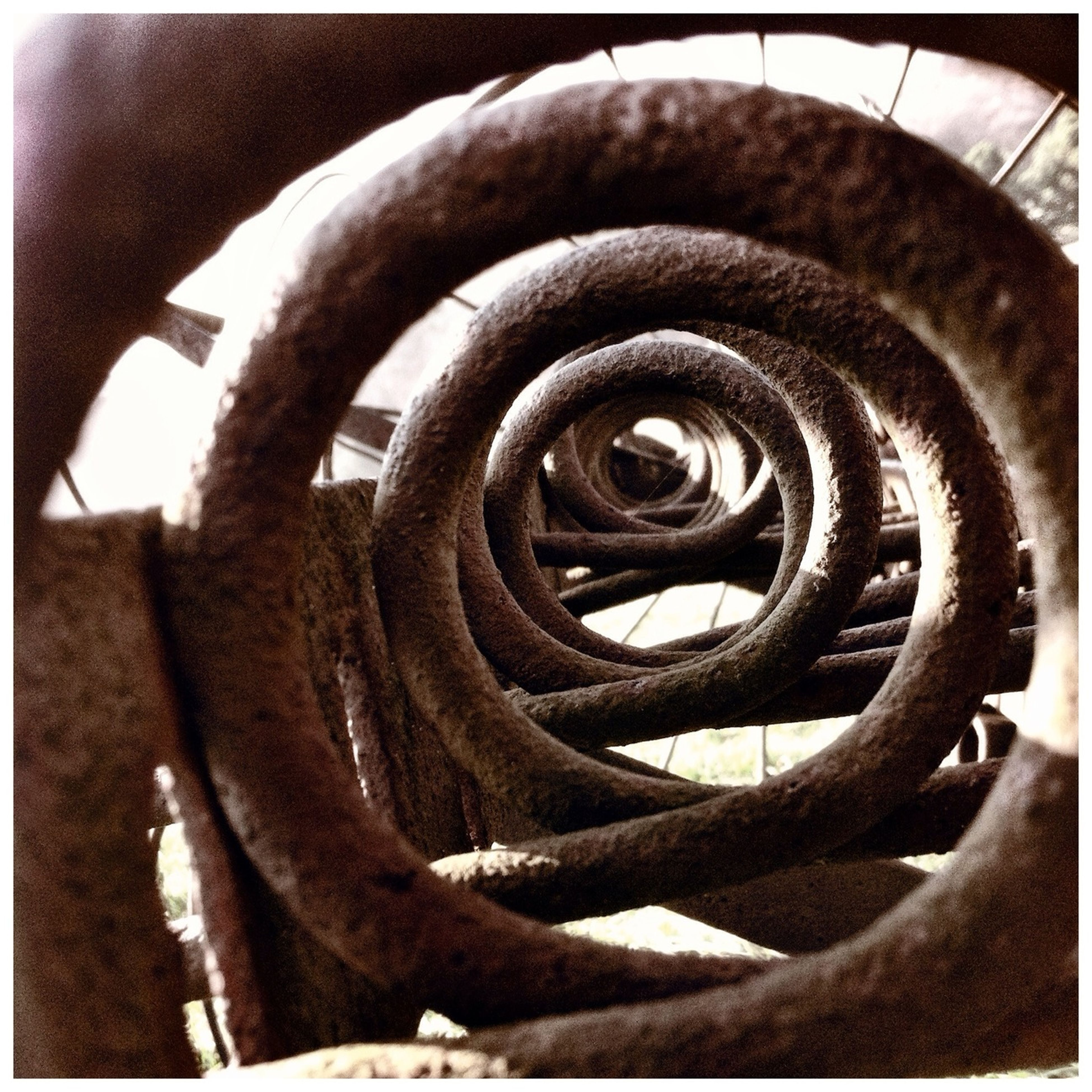 transfer print, metal, auto post production filter, rusty, close-up, metallic, old, strength, spiral, pattern, indoors, full frame, protection, no people, abandoned, weathered, damaged, day, deterioration, textured