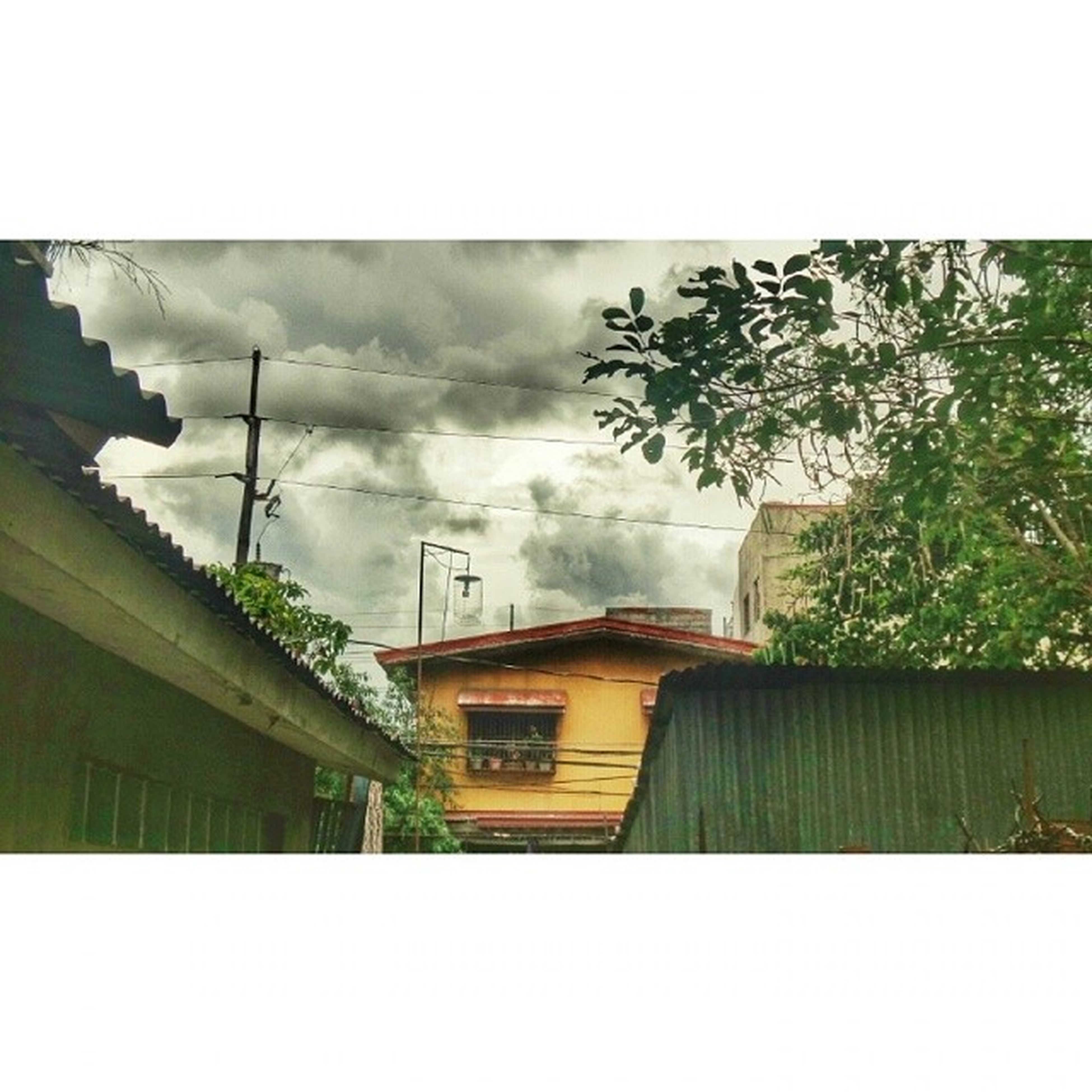 building exterior, transfer print, architecture, built structure, sky, auto post production filter, house, tree, cloud - sky, residential structure, residential building, low angle view, building, cloudy, cloud, day, outdoors, city, overcast, no people