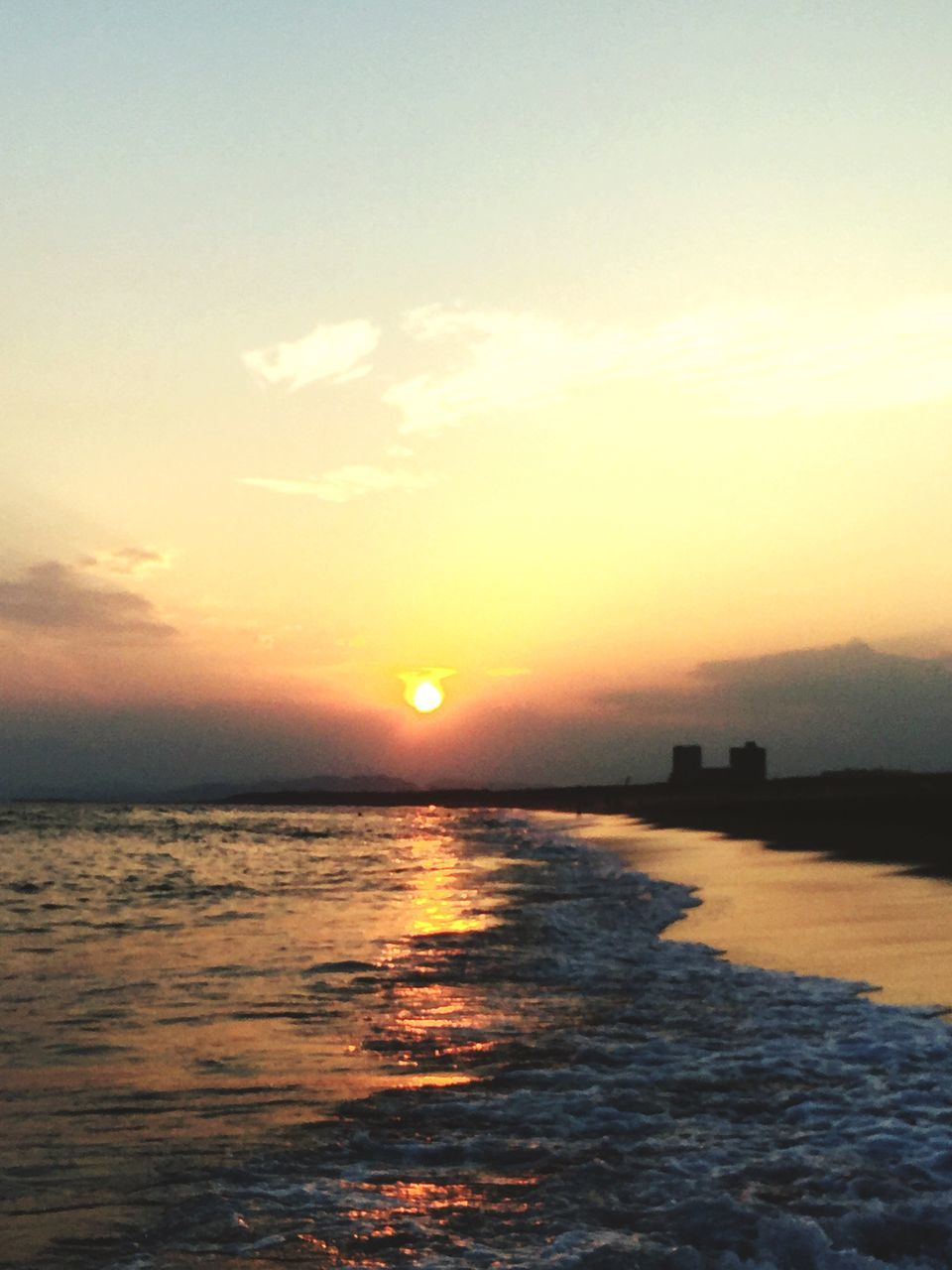 sunset, scenics, water, tranquil scene, sea, sun, tranquility, beauty in nature, waterfront, sky, orange color, idyllic, nature, calm, rippled, ocean, cloud, outdoors, majestic, seascape, non-urban scene, romantic sky, cloud - sky, wave, shore, no people, atmospheric mood, water surface, remote
