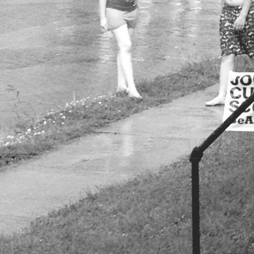 Kids Having Fun Playing In The Rain EE_Daily: Black And White Eye4black&white