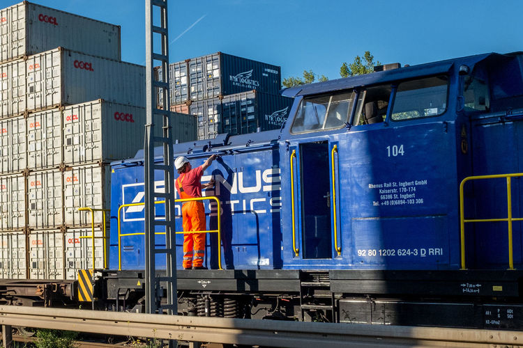 Container Railroad Track Blue Hardhat  Occupation One Person Railroad Engine Transportation