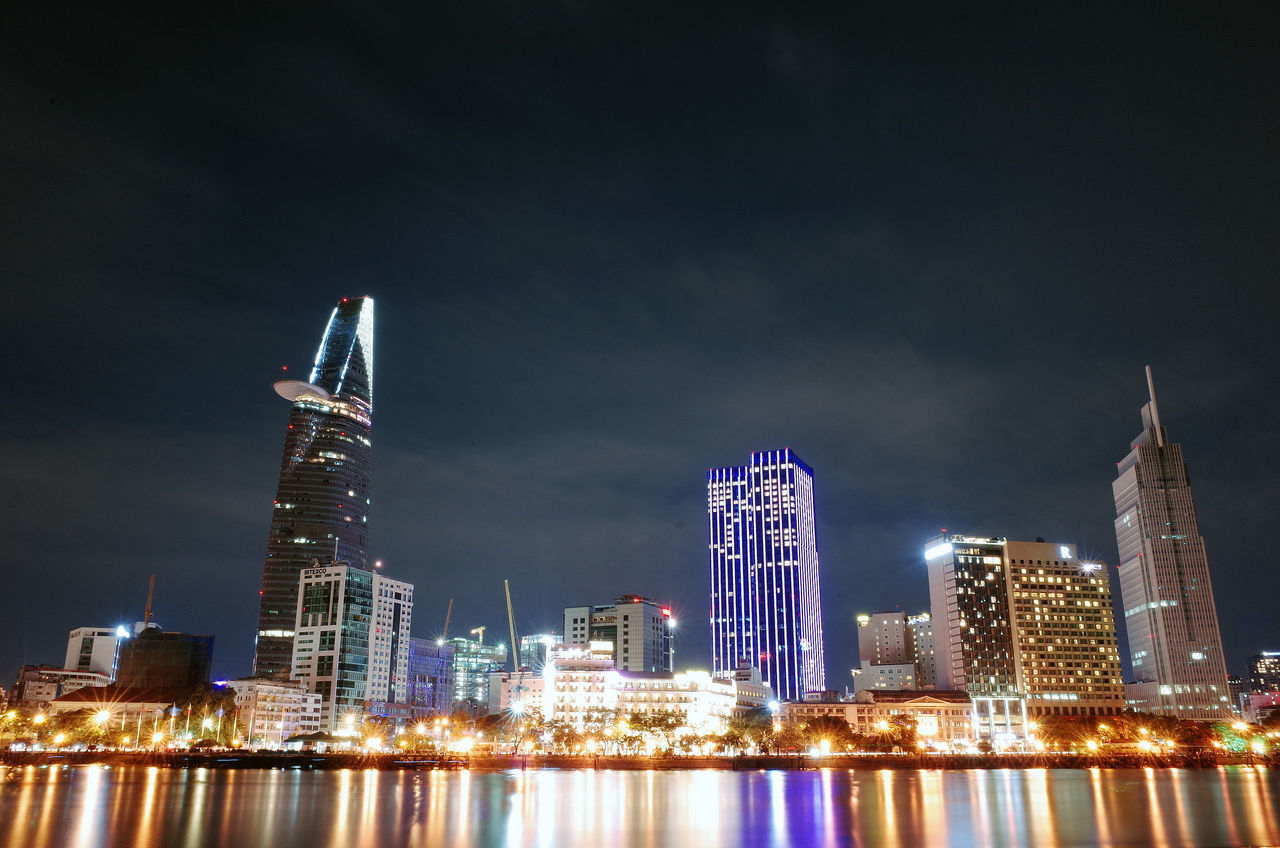 Architecture Bitexco Building Exterior Built Structure Capital Cities  City Cityscape Financial District  Ho Chi Minh City Illuminated Modern Night Office Building Reflection River River Reflection Sky Skyscraper Tall - High Tower Travel Destinations Urban Skyline Vietnam Water Waterfront