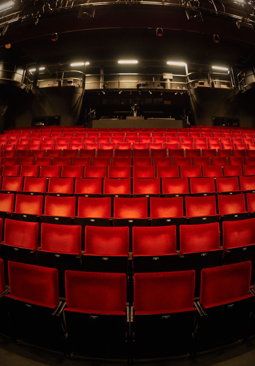 seat, chair, empty, indoors, red, auditorium, in a row, arts culture and entertainment, no people, day