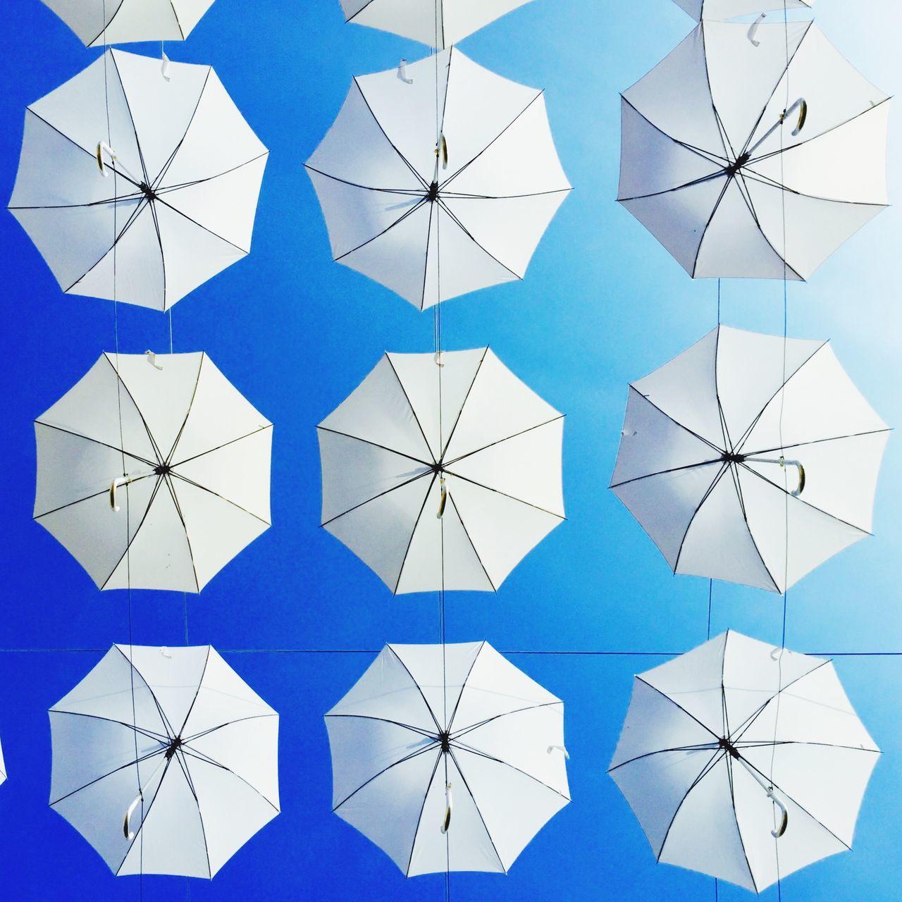 White Blue Umbrella Flowting Hanging Up