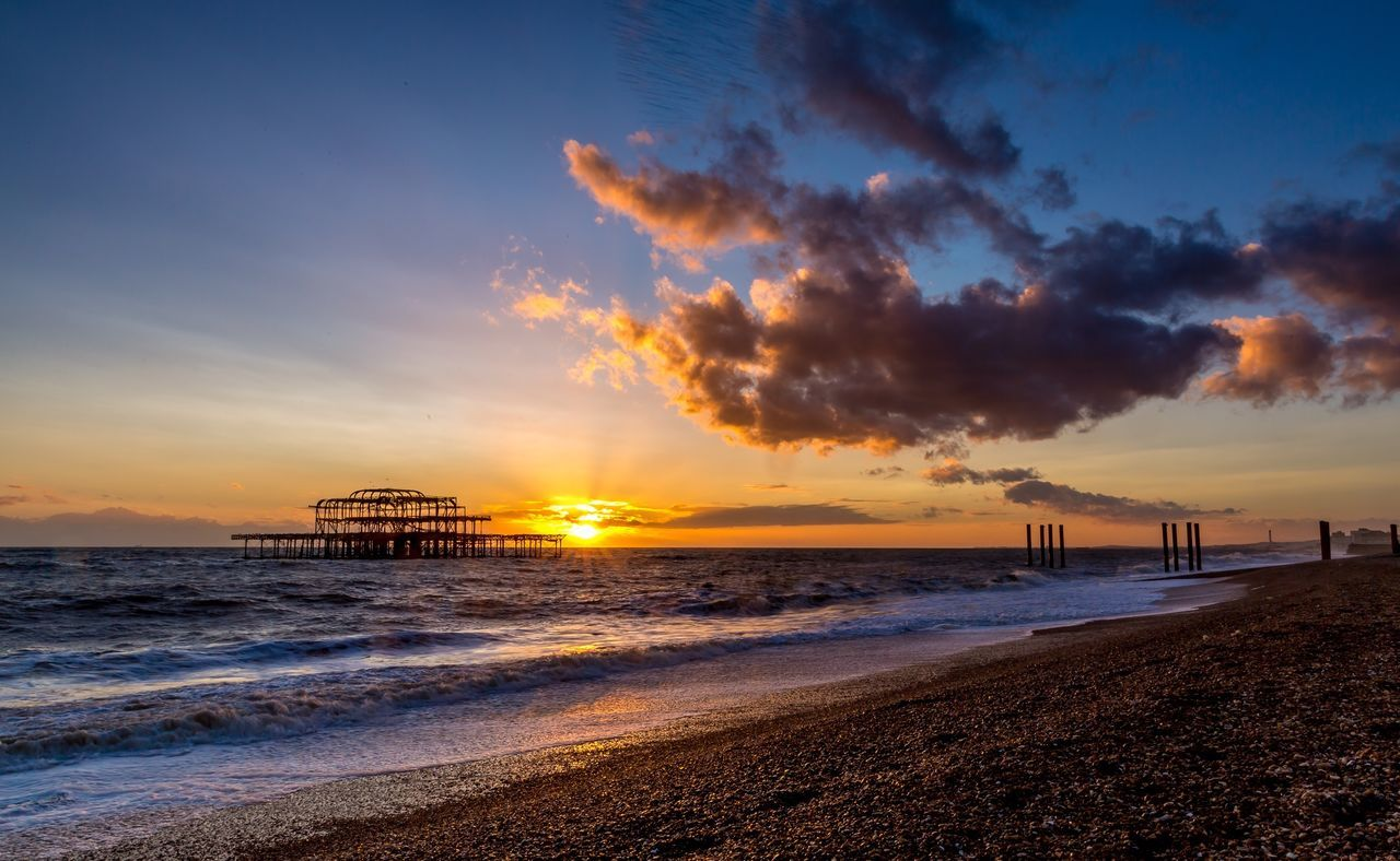 Brighton's old pier Brighton Beach Seascape Uk Seaside Water Southeast Coast Sunset Skeleton Remains Ruins Pier Clouds And Sky The City Light