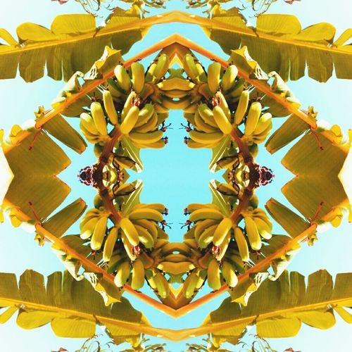 Banana Clear Sky Decoration Yellow Creativity Blue Day Outdoors Multi Colored No People Sky Banana Leaf Texture Tiling Art