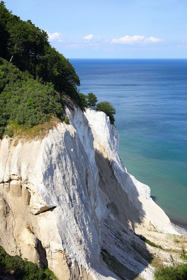 white cliffs of Moen, famous tourist attraction in Denmark Baltic Sea Beauty In Nature Blue Sky Cliff Cliffs Coastline Denmark Isle Of Moen Landscape Landscape_Collection Landscape_photography Møen Klints Nature No People Outdoors Scenery Scenics Sea Seaside Tourist Attraction  Travel Water White Cliffs