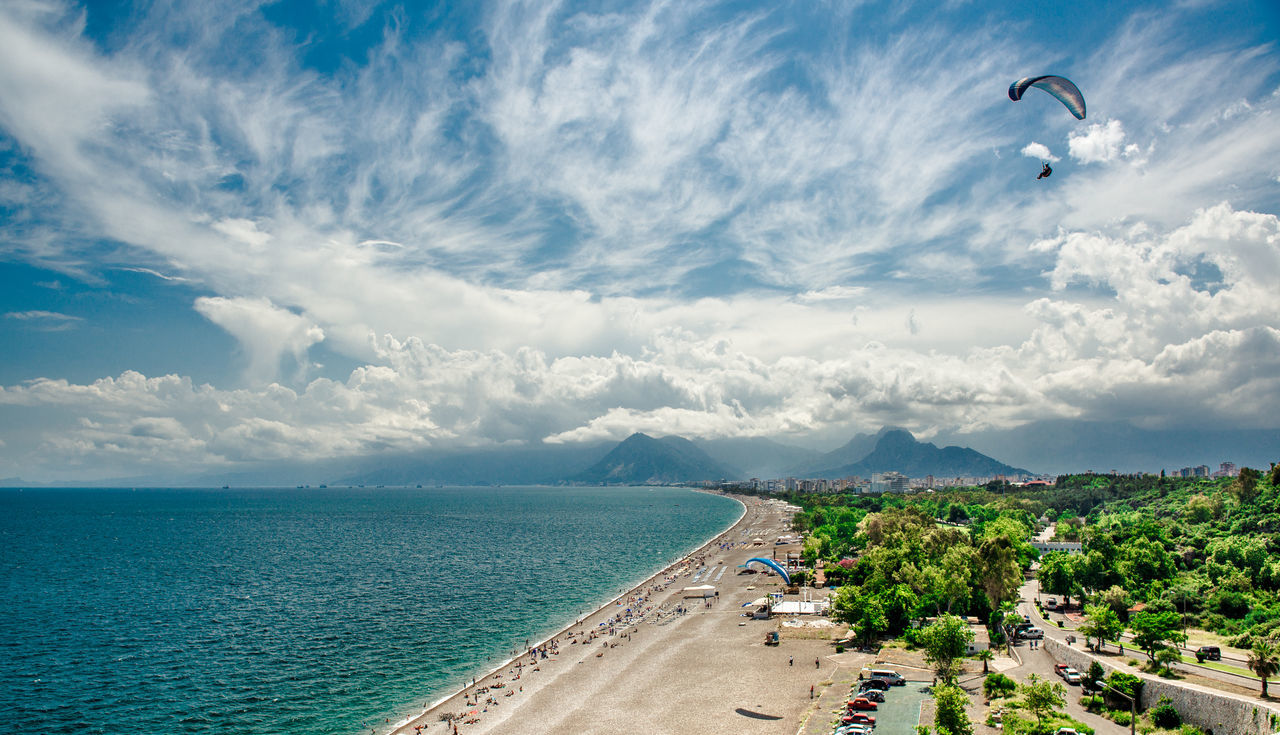 Panoramic view of Antalya city. It is biggest international sea resort in Turkey Antalya Turkey ASIA Beach Beauty In Nature Cloud - Sky Coast Coastline Day Flying Horizon Over Water Mountain Range Nature Outdoors Paraglider Paragliding Scenery Scenics Sea Sky Sun Travel Destinations Turkey Turkish Riviera Water Waterfront