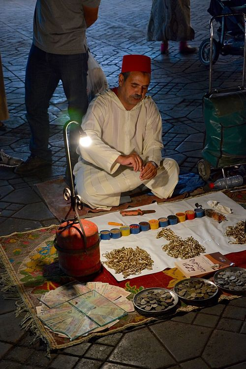 Travel Traveling Marrakesh Marrakech Marrakech Morocco Jemaa El Fnaa Jemaaelfna Nightphotography Streetphotography La Medina De Marrakech Fortuneteller mix a goodluck charm in the main square, Jemaa el Fnaa, the old medina in Marrakech