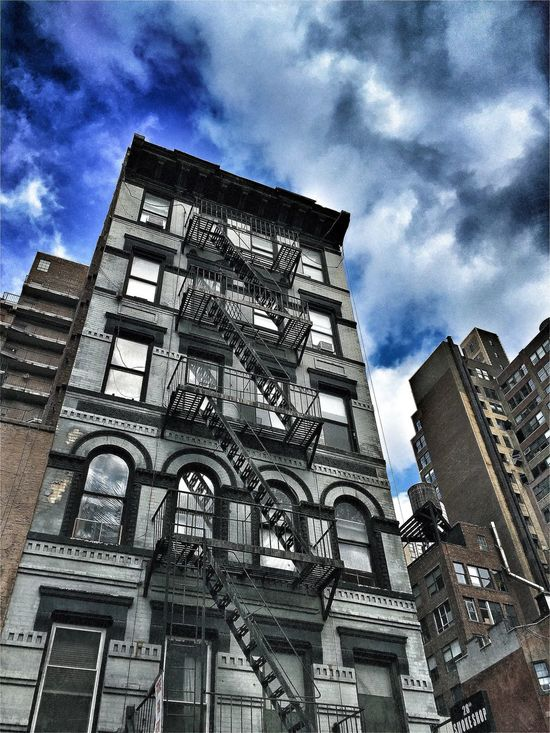 Apartment Architectural Feature Architecture Balcony Building Building Exterior Built Structure City Culture Day Exterior Façade Fire Escape Historic History Low Angle View New York City No People Outdoors Repetition Side By Side Walkup Window