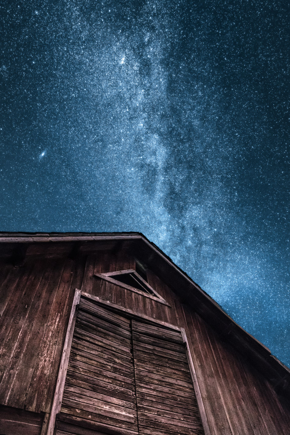 """""""Up"""". I came across a barn that seemed to want to remind us where we came from in the first place. Architecture Astronomy Awe Beauty In Nature Blue Built Structure Clear Sky Constellation Galaxy Low Angle View Milky Way Nature Night No People Outdoors Red Sky Småland Space Space And Astronomy Star - Space Star Field Sweden Wood - Material"""