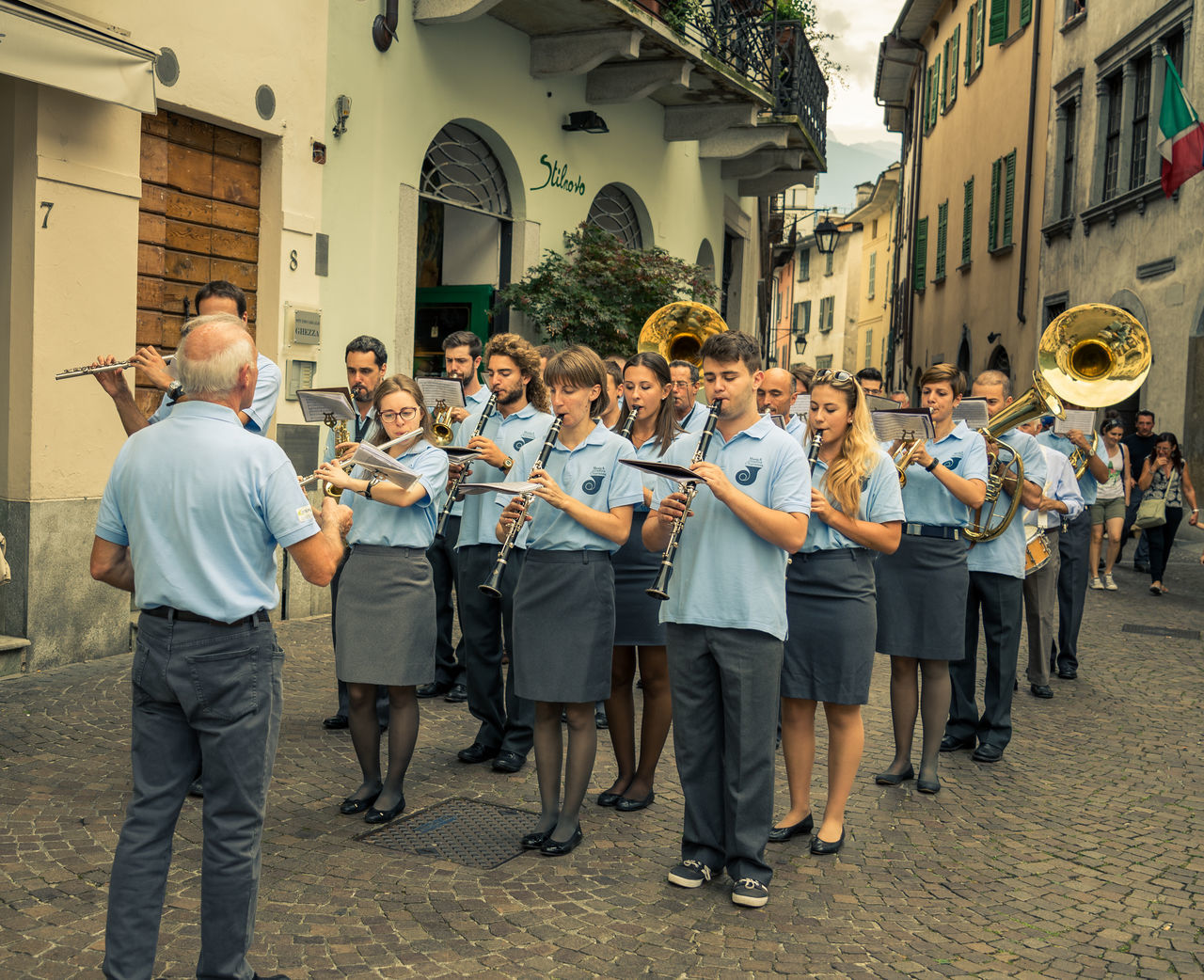 Architecture Arts Culture And Entertainment Chiavenna Instruments Italia Italy Large Group Of People Music Musical Instrument Old Town Orchestra Outdoors Parade Performance Group Playing Saxophone Streetphotography TakeoverMusic Togetherness Uniform