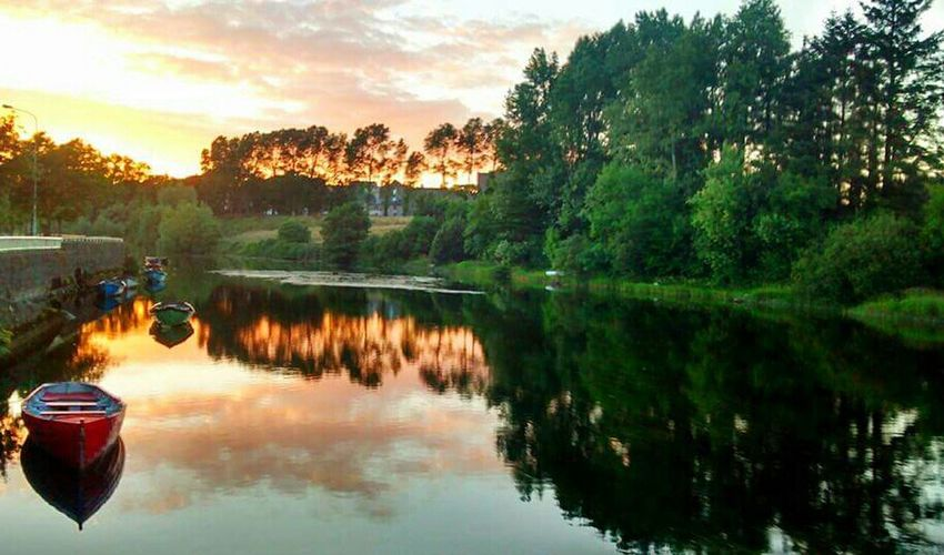 Sunset Boats River Water Reflections Nature Trees Clouds And Sky The Adventure Handbook