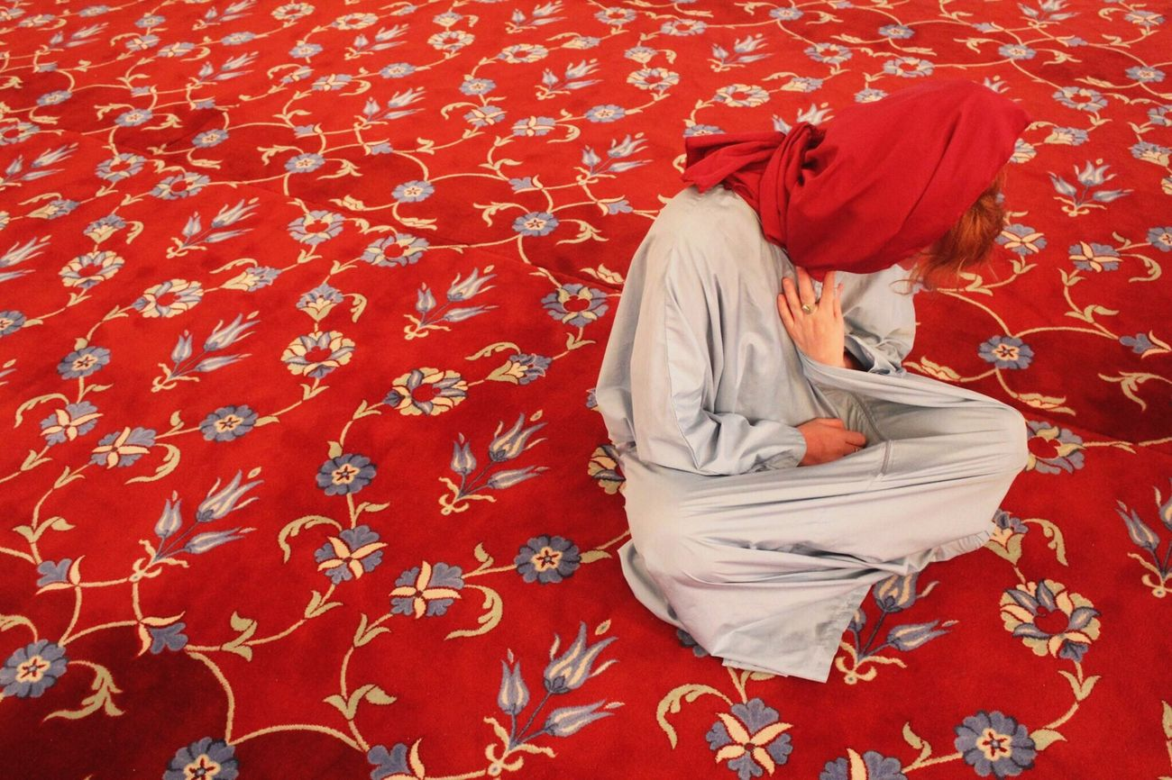 Colors And Patterns Red Sitting Three Quarter Length Religious Dress Person Cross-legged Solitude Well-dressed
