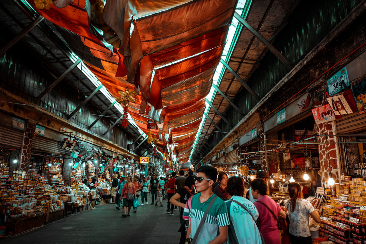 large group of people, real people, men, women, lifestyles, built structure, illuminated, market, architecture, crowd, night, indoors, people, adult, adults only