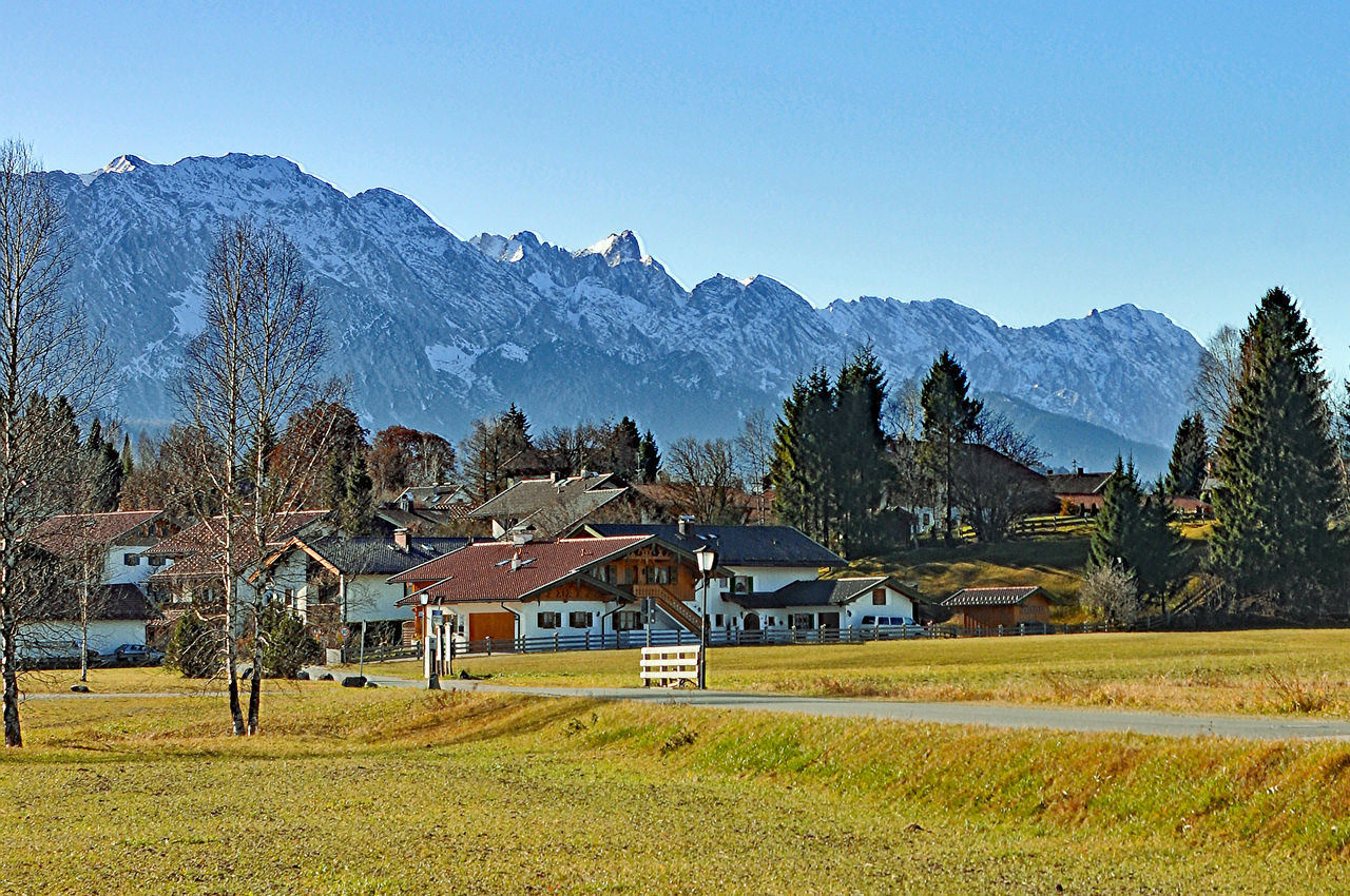 mountain, house, mountain range, built structure, architecture, building exterior, scenics, tree, tranquil scene, country house, landscape, tranquility, beauty in nature, nature, field, clear sky, no people, day, sky, outdoors, residential building, blue, rural scene, grass, barn, farmhouse