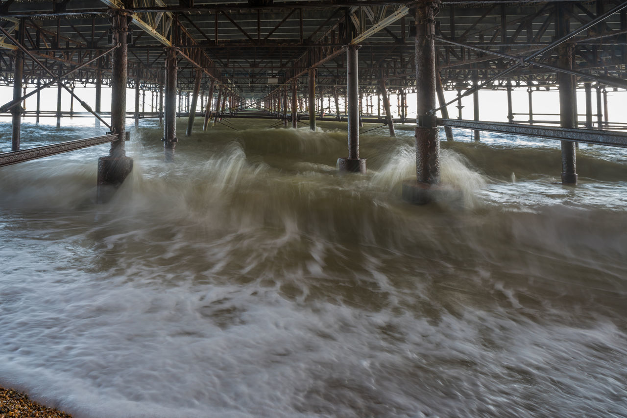 Waves crushing against pillars under the Hastings pier - long exposure Coast Coastline East Sussex East Sussex, Hastings Landmark Long Exposure No People Outdoors Pier Rough Sea Sea Shingle Beach Shore Shoreline Structure Under The Pier View Water Waterfront Waves