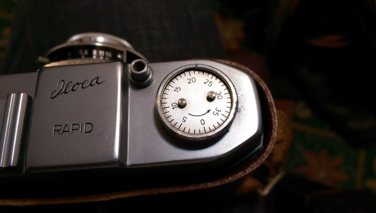 close-up, high angle view, communication, no people, table, indoors, time, technology, gauge, day, clock