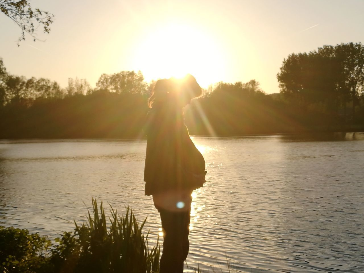 Lake Sunset Water One Person Sunlight Tree Outdoors Nature People Summer Silhouette Spirituality Only Women One Woman Only Adult Sky Adults Only Human Body Part Beauty In Nature Vacations Pregnant 40weeks 1daytogo P9leica The Portraitist - 2017 EyeEm Awards