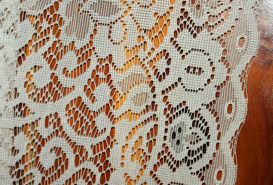 A vintage lace curtain against golden wood tones. Antique Backgrounds Close-up Curtain Day Fabric Full Frame Golden Indoors  Lace No People Pattern Textile Textured  Vintage Wood - Material