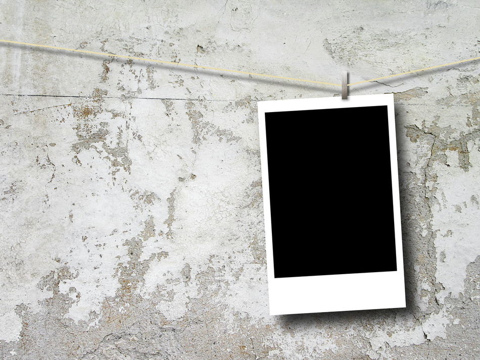 Blank rectangular photo frame hanged bu peg against gray concrete wall Backgrounds Black Blank Close-up Concrete Wall Copy Space Day Frame Indoors  Instant Instantphoto No People Photo Picture Rectangular Frame Textured  White Background