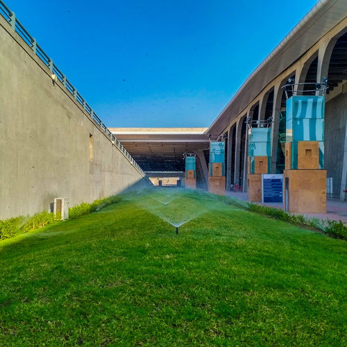 Grass Architecture Outdoors Sport Building Exterior No People EyeEmNewHere Low Angle View Photographing Go Green Feel Green Nature Resist EyeEm Diversity The Secret Spaces Long Goodbye