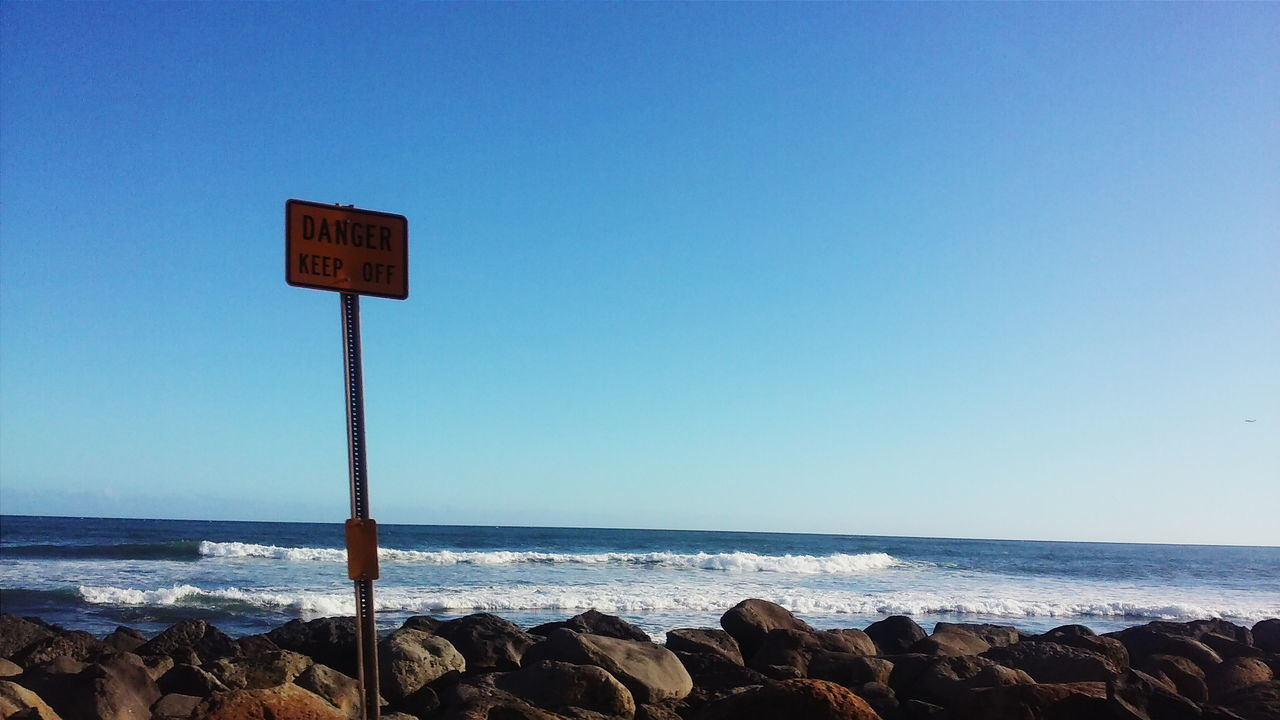 Beautiful stock photos of sign,  Beach,  Beauty In Nature,  Blue,  Clear Sky