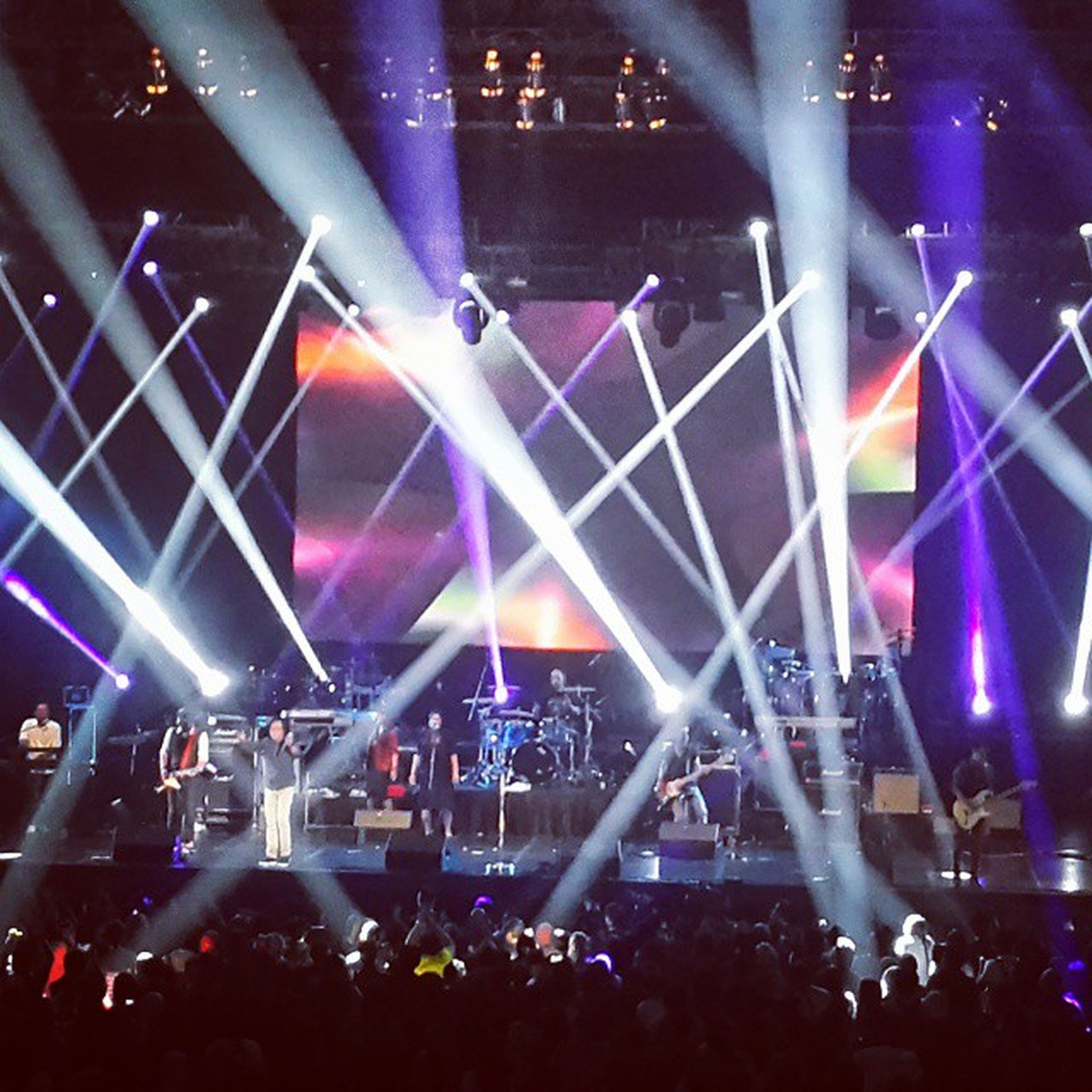 large group of people, illuminated, crowd, lifestyles, arts culture and entertainment, music, nightlife, person, men, leisure activity, night, enjoyment, indoors, stage - performance space, performance, youth culture, popular music concert, event