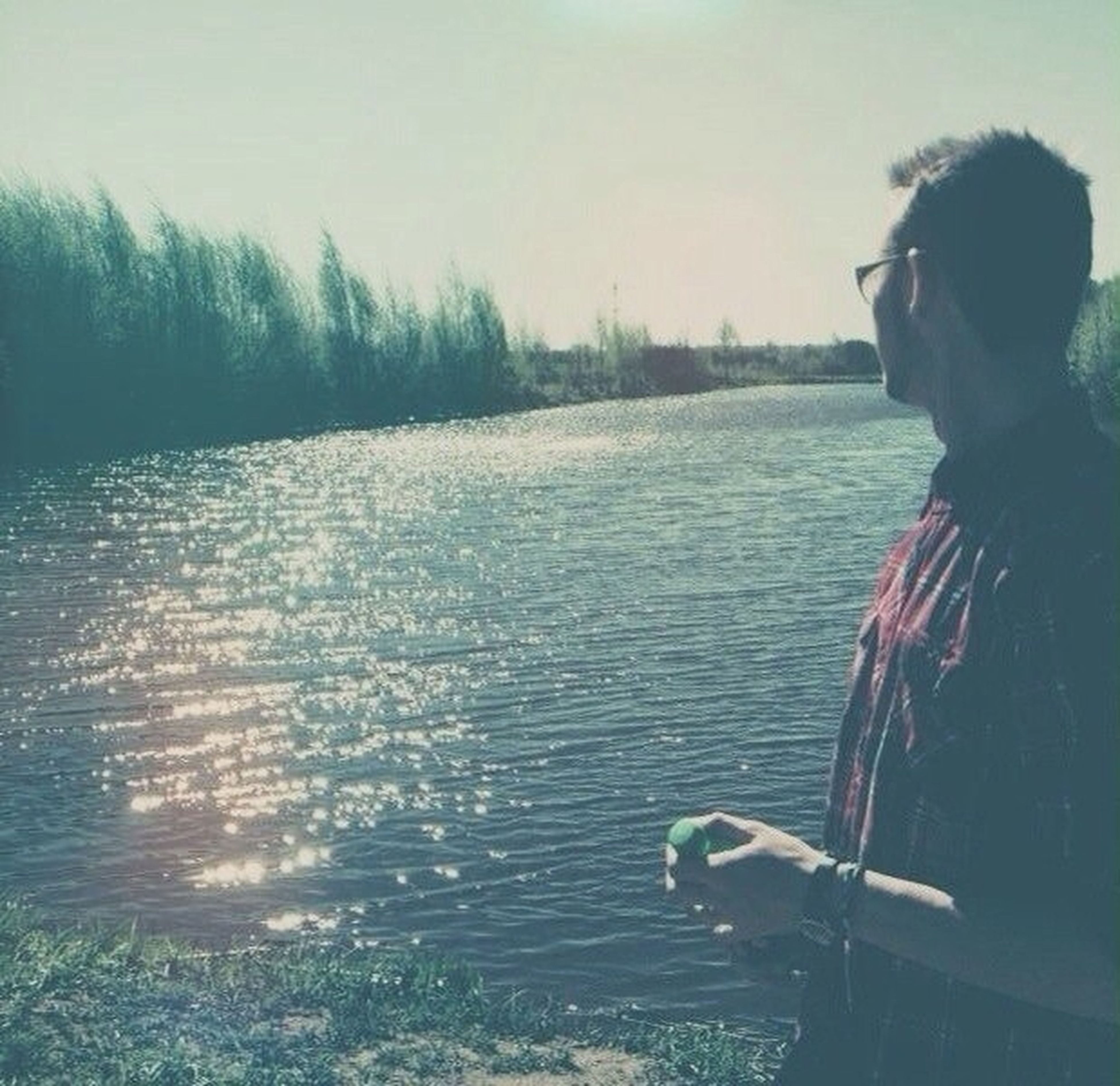 water, low section, lifestyles, leisure activity, person, men, unrecognizable person, animal themes, one animal, standing, outdoors, domestic animals, part of, day, sunlight, pets, mammal
