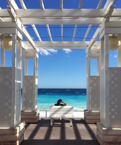 Sea Horizon Over Water Water Rear View One Person Sunlight Real People Day Sky Shadow Leisure Activity Built Structure Scenics Sitting Nature Beauty In Nature Architecture Outdoors Women Blue Sommergefühle