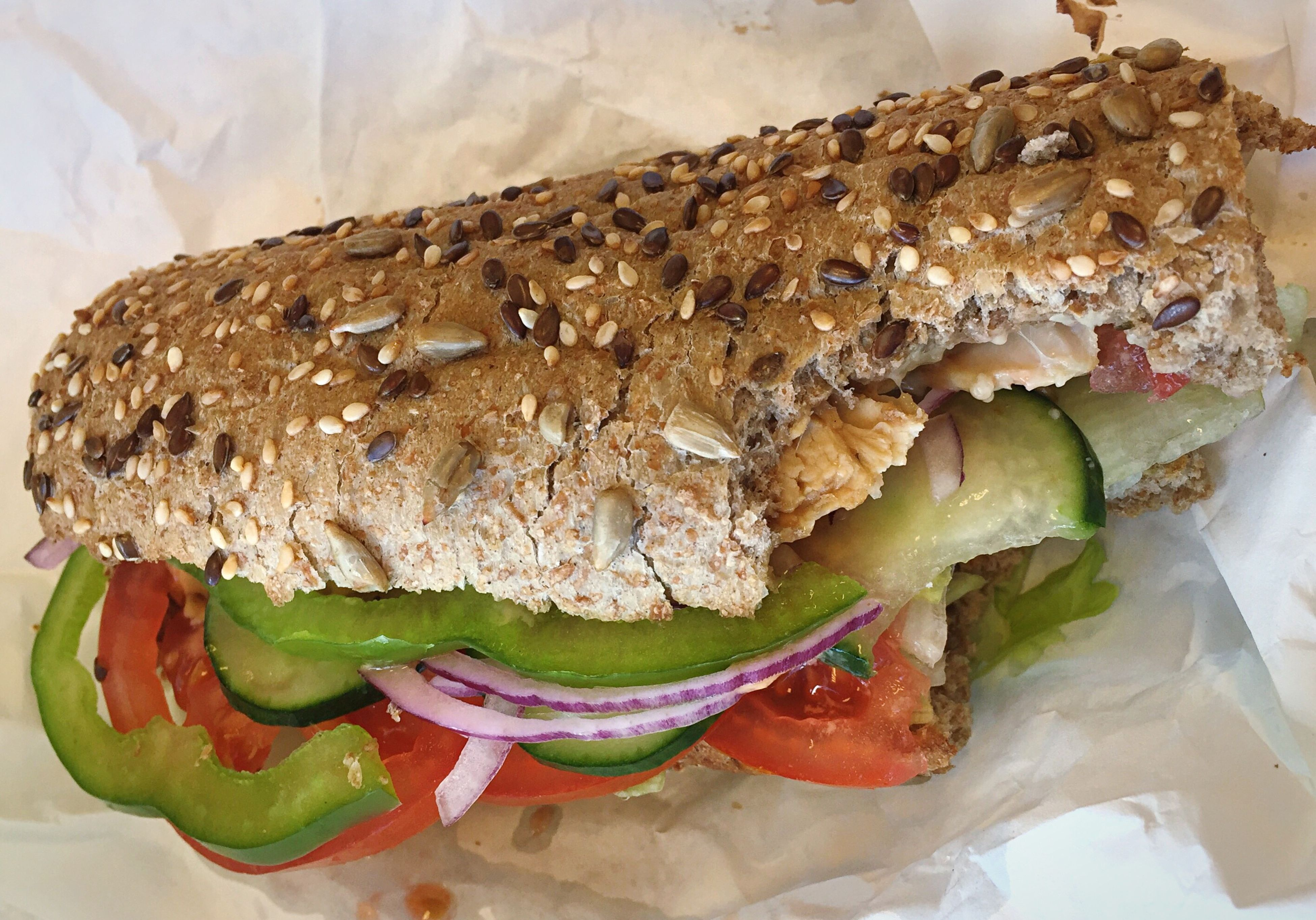 food and drink, sandwich, food, bread, freshness, indoors, lettuce, tomato, healthy eating, slice, no people, ready-to-eat, bagel, serving size, close-up, wholegrain, day