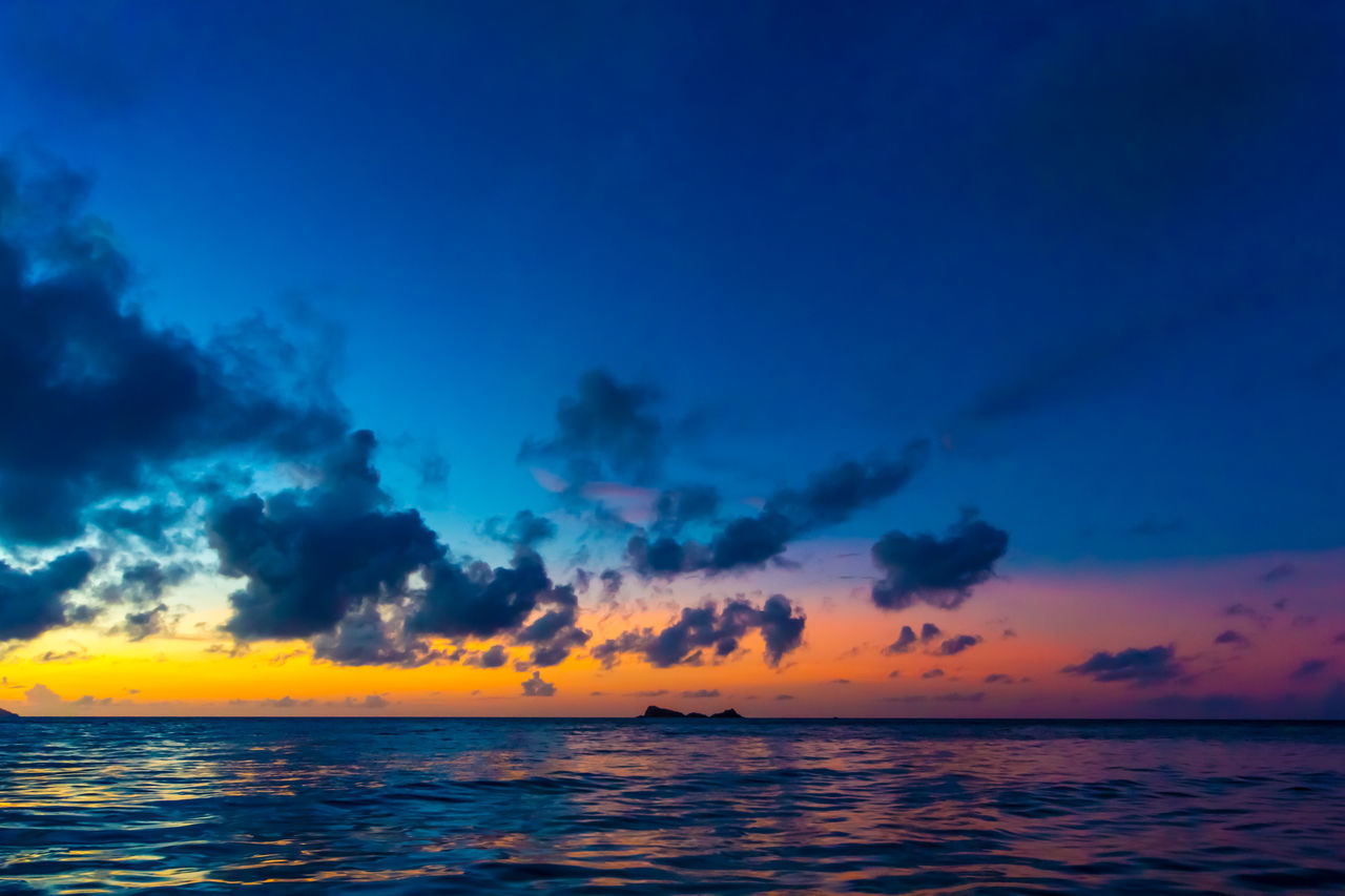 Beauty In Nature Blue Sky Calm Caribbean Sea Colorful Horizon Over Water Idyllic Moody Sky Nature No People Outdoors Scenics Sea Seascape Sky Sunset Tranquil Scene Tranquility Travel Vacation Vibrant Colors Virgin Gorda Water