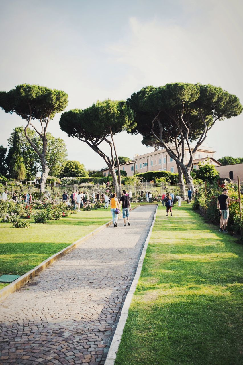 Crowd In Rome Rose Garden Against Sky