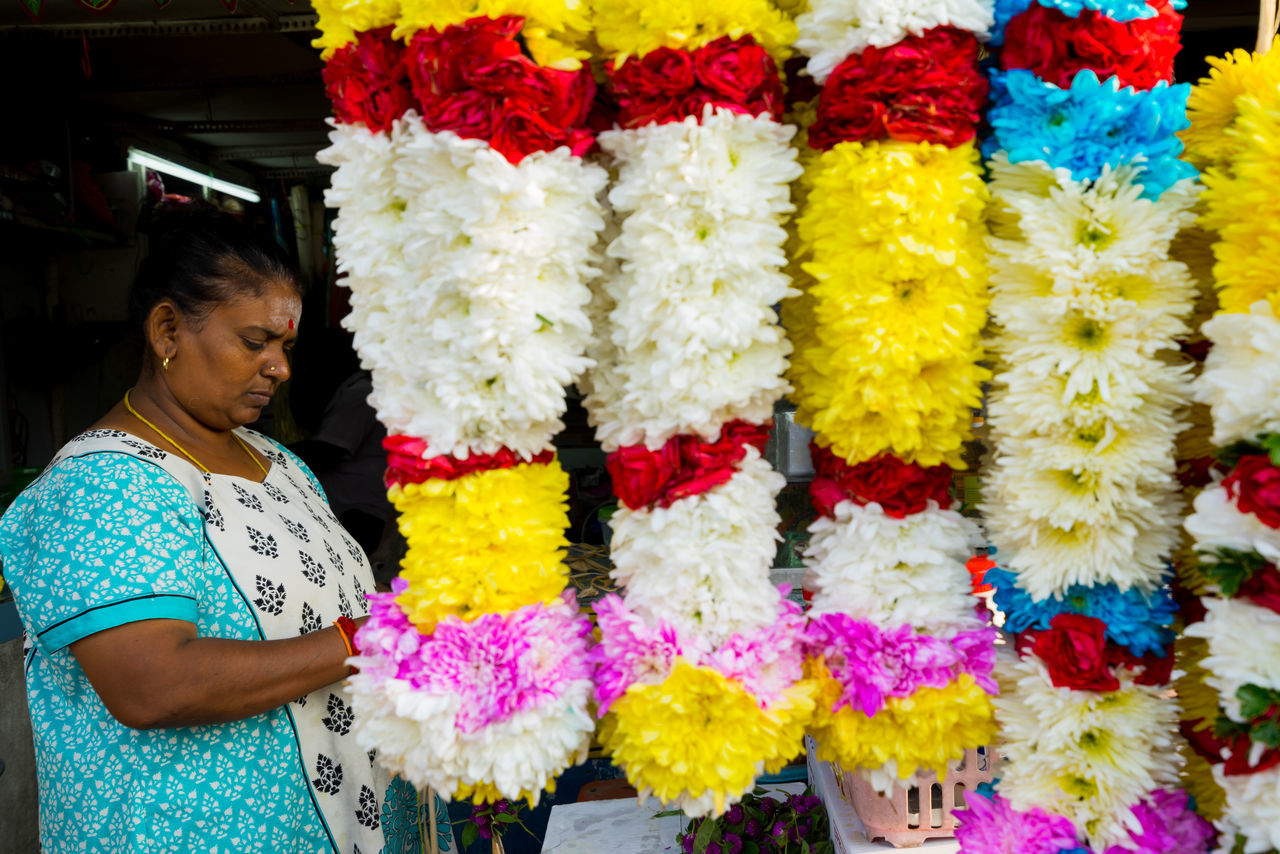 BATU CAVES, MALAYSIA - 9TH FEBRUARY 2017; Hindu devotees performing a pray session during Thaipusam festival in Batu Caves temple, celebrating Lord Murugan victory over the demon Soorapadman. Adult Batu Caves -Malaysia Day Floral Garland Flower Flower Arrangement Fragility Hinduism Multi Colored One Person One Woman Only Only Women Outdoors People Standing Thaipusam 2017 Women
