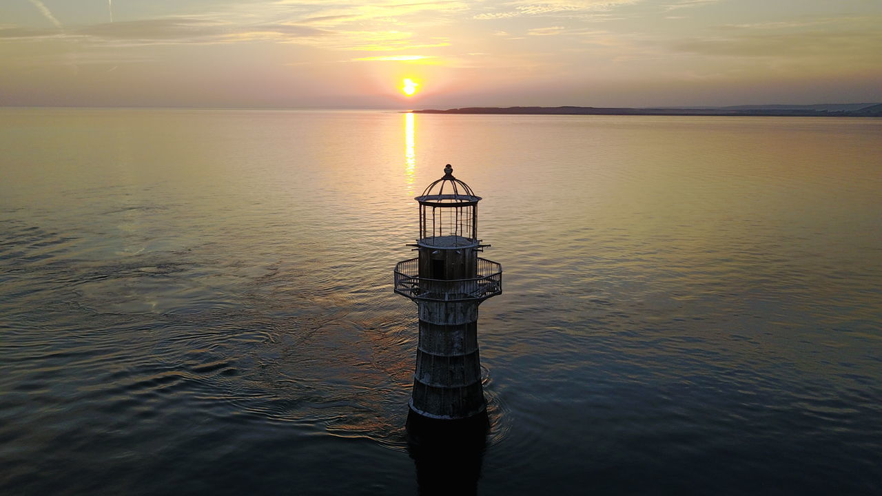 Lighthouse... Sunset Reflection Tranquility Sun Sunlight Landscape Horizon Over Water Travel Destinations Nature Sea And Sky Seascape Ripples In The Water Rusty Metal Lighthouse Calm Sea Calm And Serene Gower Peninsular South Wales Holiday Destination