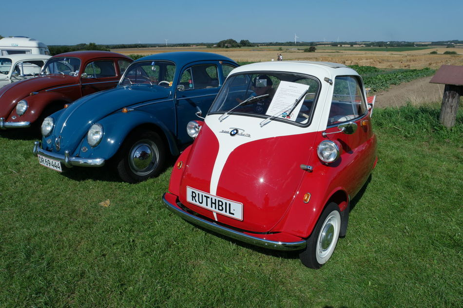 Old cars Blue BMW Isetta Car Close-up Day Field Grass Grassy Green Color Isetta Land Vehicle Mode Of Transport No People Outdoors Red Sunlight Transportation Travel Vehicle Vintage Car VW Beetle Vw Beetles